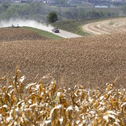 A pickup truck travels a dusty road amidst dry corn fields near Bennington, Neb., Thursday, Sept. 6, 2012. The remnants of Hurricane Isaac dumped heavy rain on some key Midwest farming states that dramatically lessened the drought there, but conditions worsened in two of the nation's biggest corn producers, Iowa and Nebraska, which missed out on the badly needed moisture, according to a drought report released Thursday.