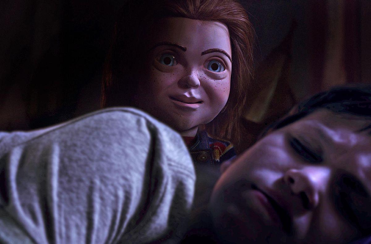 Chucky doll rising from behind a sleeping boy