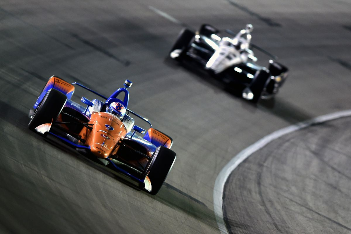 Scott Dixon, driver of the #9 PNC Bank Chip Ganassi Racing Honda, leads Simon Pagenaud, driver of the #22 DXC Technology Team Penske Chevrolet, during the Verizon IndyCar Series DXC Technology 600 at Texas Motor Speedway on June 9, 2018 in Fort Worth, Texas.