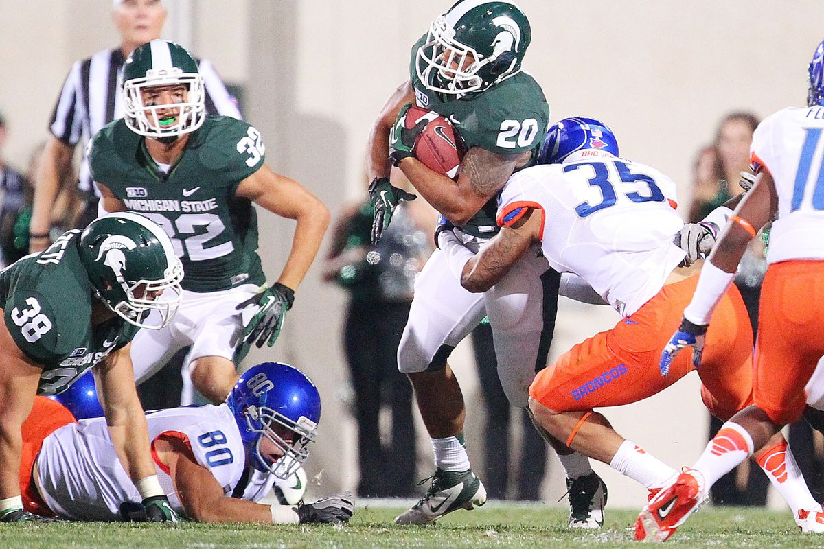 August 31, 2012; East Lansing, MI, USA; Michigan State Spartans running back Nick Hill (20) returns the kick off during the first half against the Boise State Broncos at Spartan Stadium.    Mandatory Credit: Mike Carter-US PRESSWIRE