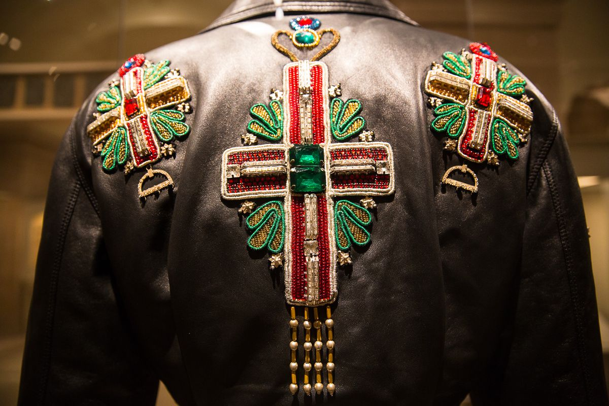 A leather jacket with a huge crystal crucifix on the back.