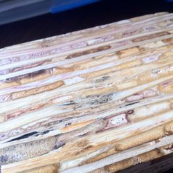 pressed sorghum reeds that will make up table tops.
