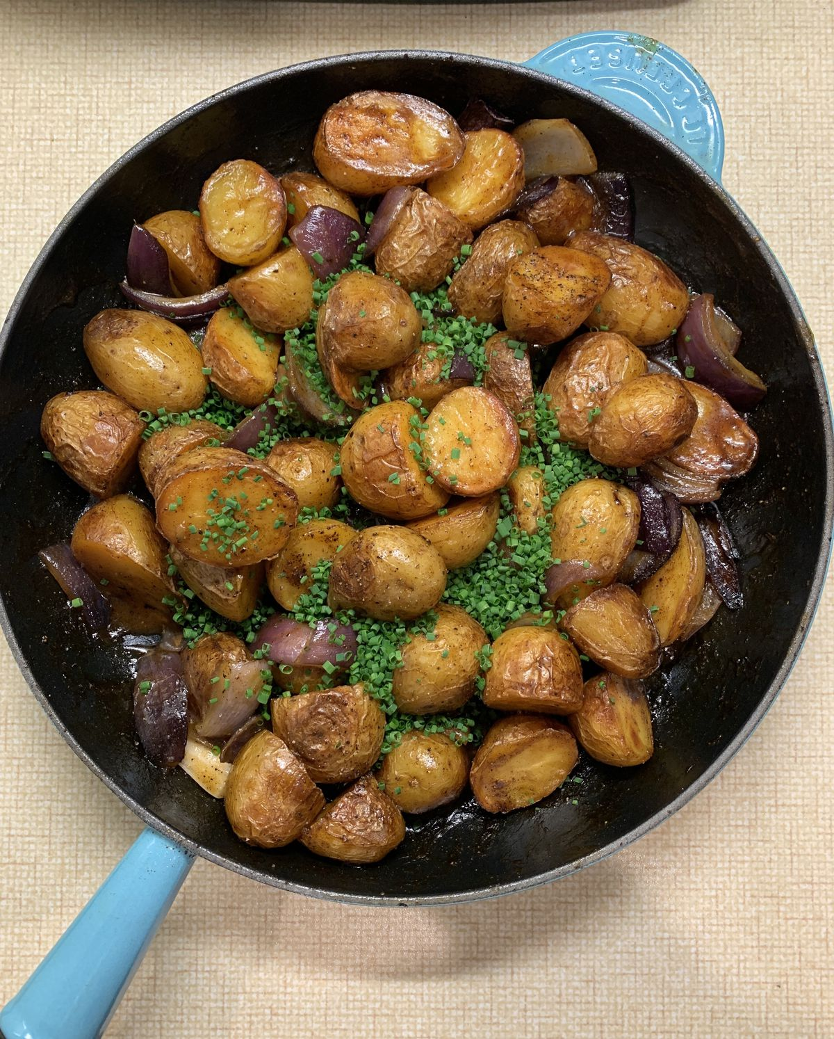 Spiced roast potatoes with chicken and tarragon gravy by Jeremy Chan of Michelin-starred central London restaurant Ikoyi