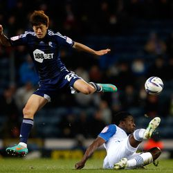 Dickson Etuhu (R) of Blackburn in action with Lee Chung-Yong of Bolton during the npower Championship match between Blackburn Rovers and Bolton Wanderers at Ewood Park on November 28, 2012 in Blackburn, England. (Photo by Paul Thomas/Getty Images)