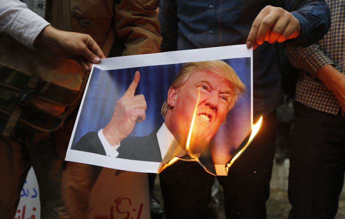 Iranians burn an image of US President Donald Trump during an anti-US demonstration outside the former US embassy headquarters in the capital Tehran on May 9, 2018.
