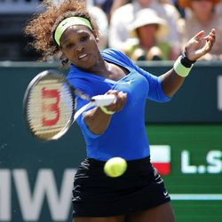 Serena Williams hits a shot to Lucie Safarova, of the Czech Republic, during the final at the Family Circle Cup tennis tournament in Charleston, S.C., Sunday, April 8, 2012. Williams won 6-0, 6-1.