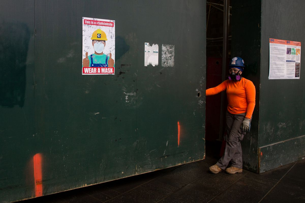 Construction workers were encouraged to wear masks at a site in Times Square, June 22, 2020.
