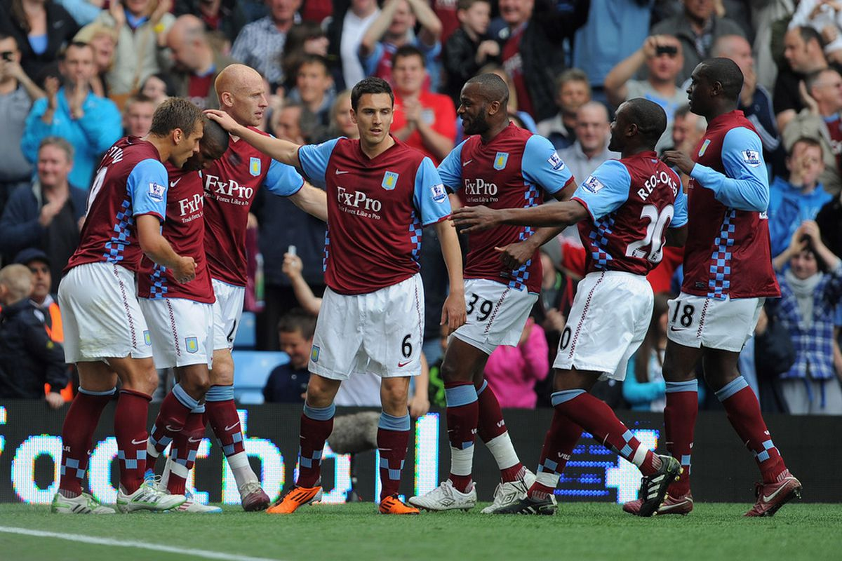 In my head I imagine that Aston Villa captain Stiliyan Petrov is asking Ashley Young whether he heard him correctly.(Photo by Michael Regan/Getty Images)