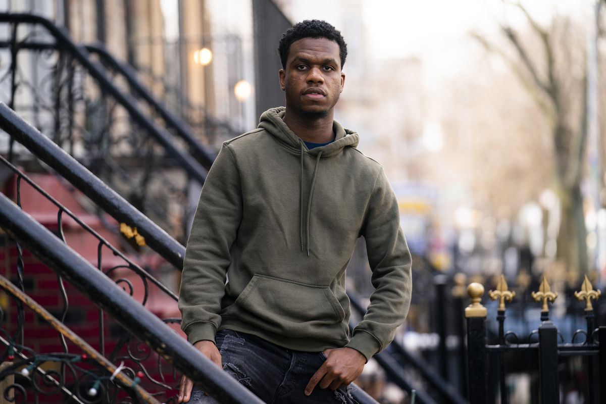 Mikel Haye poses for a portrait on his stoop, Friday, March 12, 2021, in the Brooklyn borough of New York.