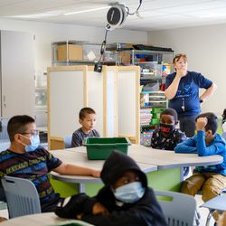 A teacher leads her students in a classroom discussion during a STEM class. The vast majority of Aurora students are starting the year in-person.