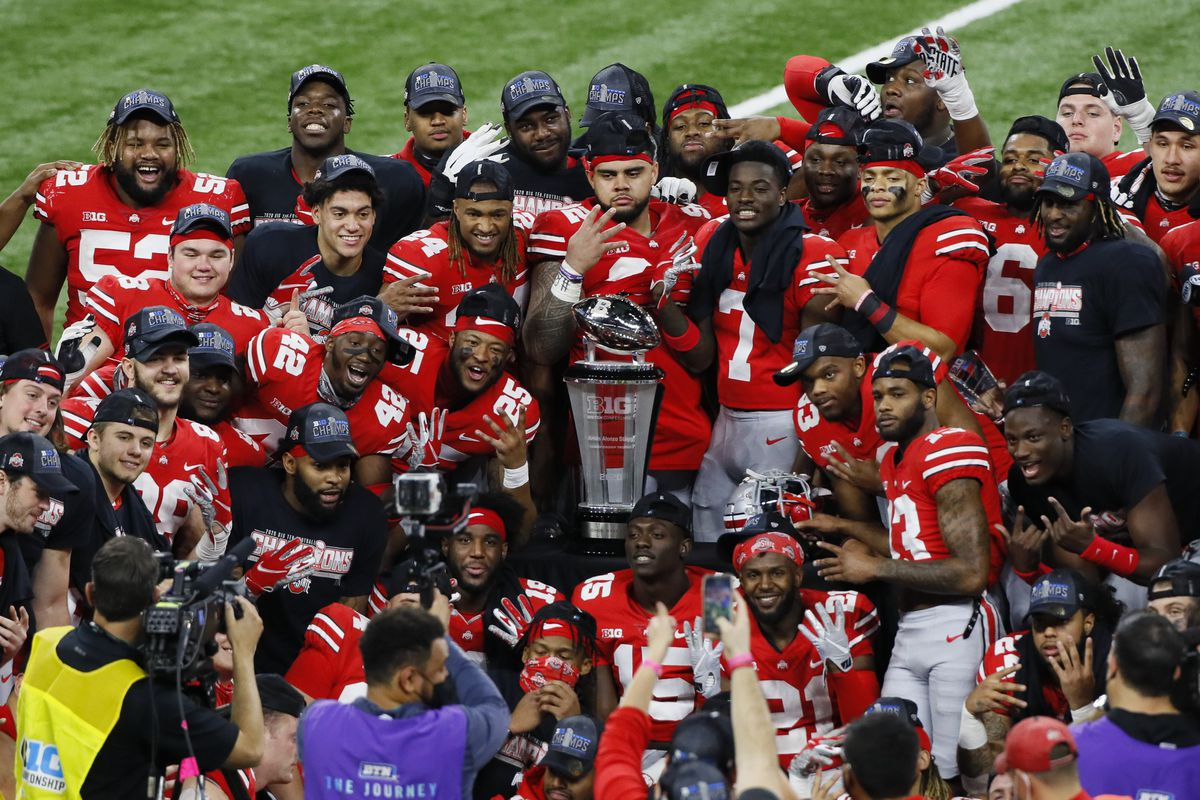 Ohio State Buckeyes celebrate their fourth-straight Big Ten championship with the Stagg Championship Trophy following their 22-10 win over Northwestern in the Big Ten Championship football game at Lucas Oil Stadium in Indianapolis on Saturday, Dec. 19, 2020.