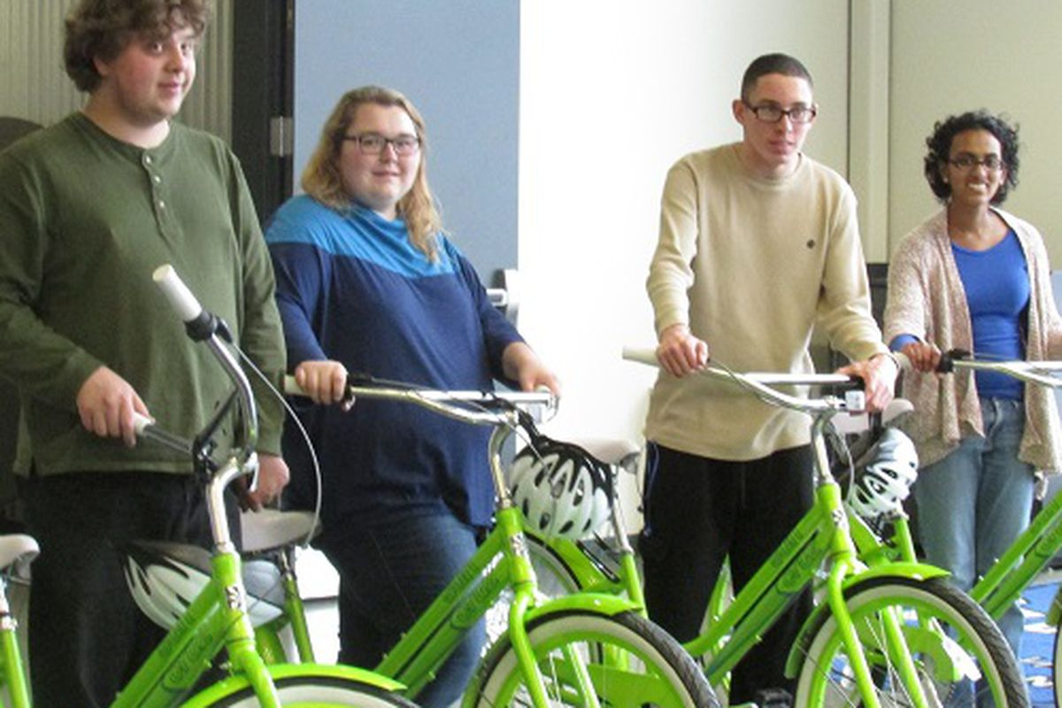 """Students in the """"Transitions In Englewood Schools Program"""" with new bikes at a ribbon-cuttin g ceremony on March 7, 2014."""