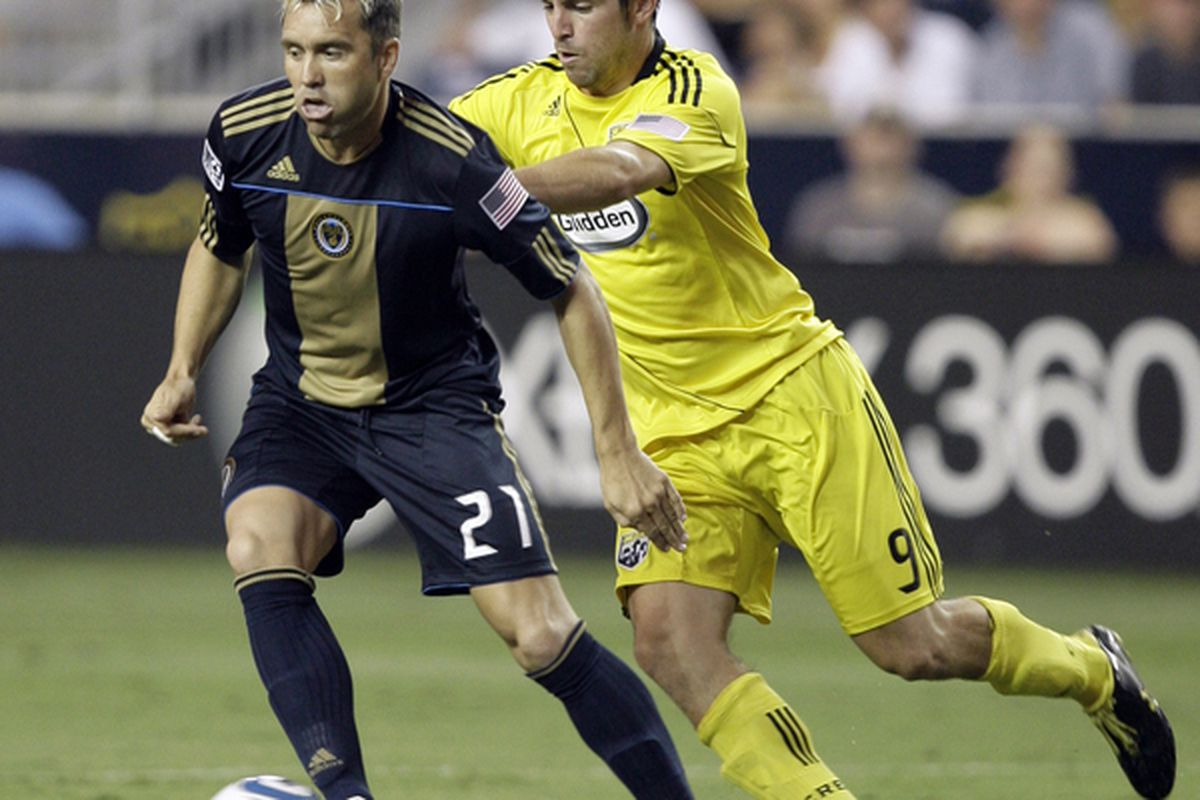 CHESTER PA - AUGUST 5:  Forward Jason Garvey #9 of the Columbus Crew pushes midfielder Eduardo Coudet #21of the Philadelphia Union during the first half at PPL Park on August 5 2010 in Chester Pennsylvania.  (Photo by Chris Gardner/Getty Images)