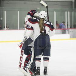 Team USA goaltender Maddie Rooney and Team USA defender Kali Flanagan after the game.