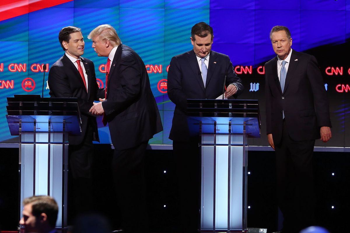 Republican presidential candidates, Sen. Marco Rubio (R-FL), Donald Trump, Sen. Ted Cruz (R-TX), and Ohio Gov. John Kasich stand onstage at the end of their debate on CNN.