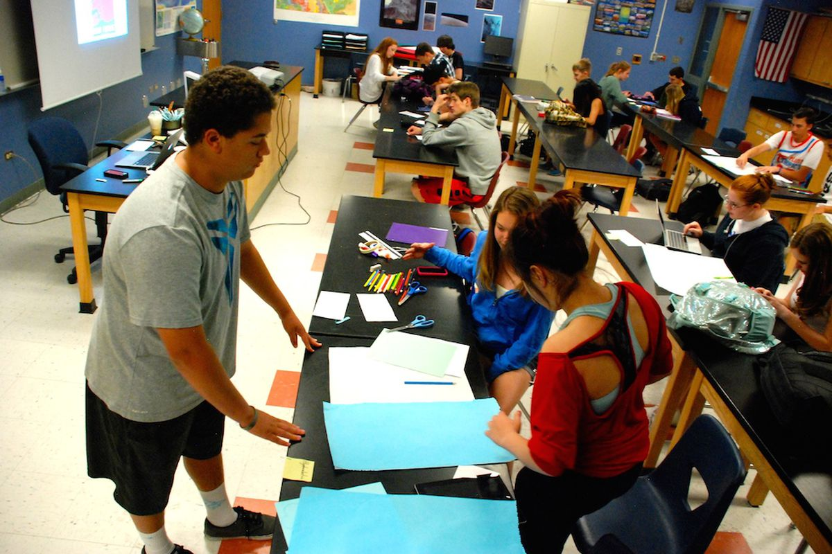 Sophomores at Highlands Ranch High School work on a science project.