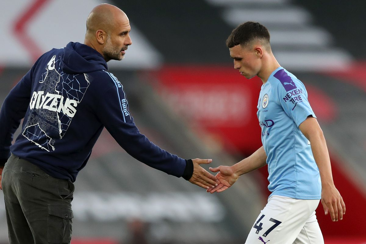 Pep Guardiola interacts with Phil Foden - Manchester City - Premier League