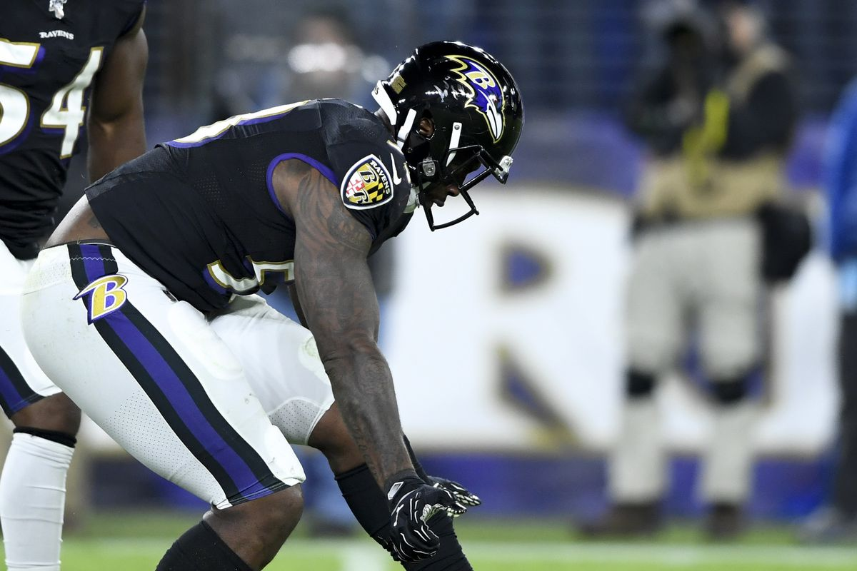 Baltimore Ravens defensive end Jihad Ward reacts after sacking New England Patriots quarterback Tom Brady during the fourth quarter at M&T Bank Stadium.