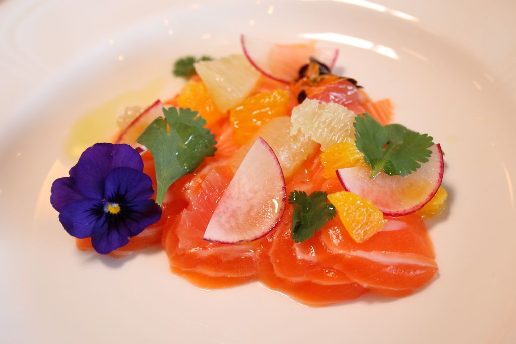 The Norwegian Trout Belly Crudo is served with citrus supremes, radish and citrus and soy vinaigrette at The Heritage restaurant.