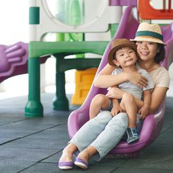 Parents are trying to keep their children safe when they zoom down a playground slide with them, but doing this makes your child more likely to be hurt, an emergency-room physician says.