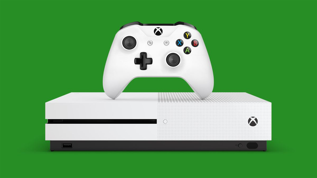 Xbox One S plus white controller on green background