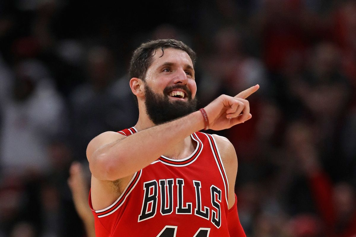 Nikola Mirotic smiling and pointing on the court