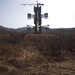 North Korea's Unha-3 rocket, slated for liftoff between April 12-16, stands at Sohae Satellite Station in Tongchang-ri, North Korea on Sunday April 8, 2012. North Korean space officials have moved a long-range rocket into position for this week's controversial satellite launch, vowing Sunday to push ahead with their plans in defiance of international warnings against violating a ban on missile activity.(AP Photo/David Guttenfelder)