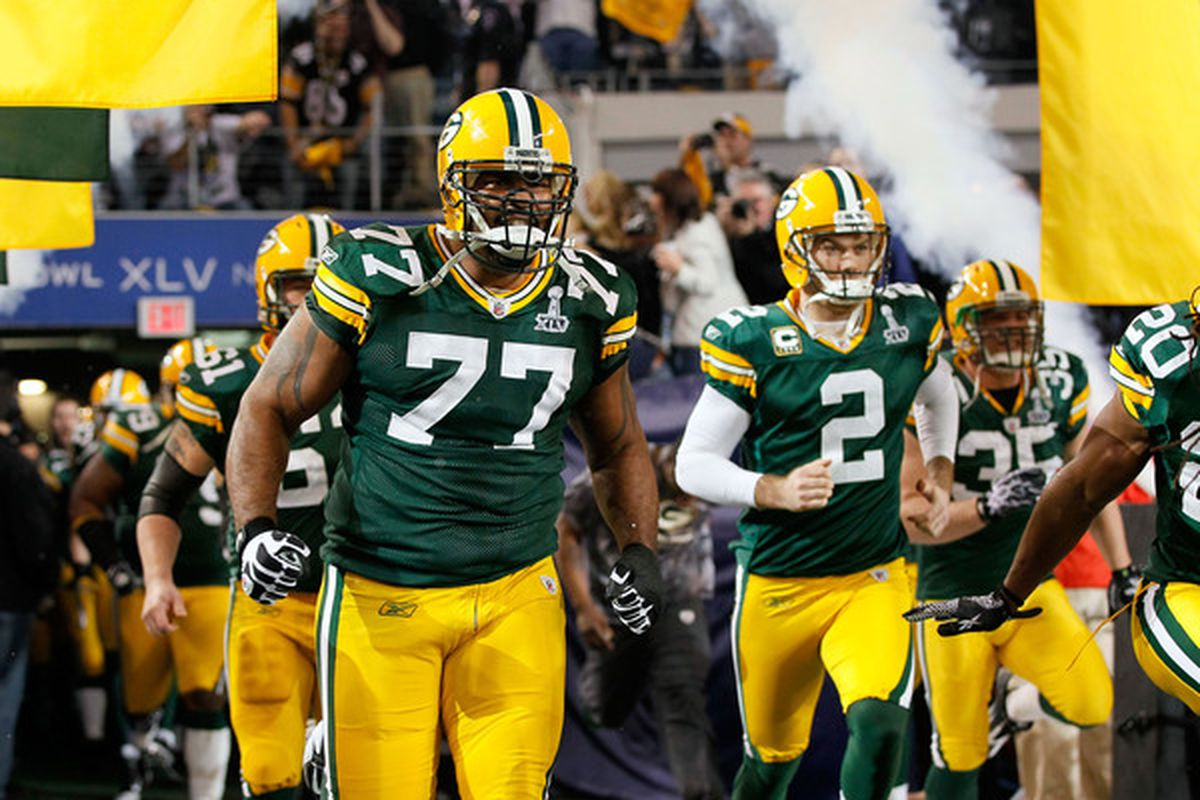 ARLINGTON TX - FEBRUARY 06: Cullen Jenkins #77 and Mason Crosby #2 of the Green Bay Packers run onto the field prior to Super Bowl XLV at Cowboys Stadium on February 6 2011 in Arlington Texas.  (Photo by Kevin C. Cox/Getty Images)