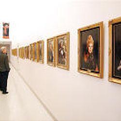 Utah tenor Michael Ballam walks through Avenue del'Opera hallway that has photographs of 10 years worth of productions.