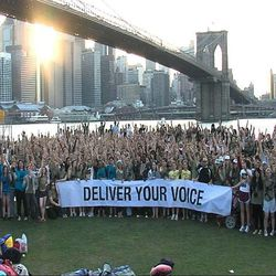 """This image provided by Invisible Children shows a scene from the film, """"Kony 2012 Part II"""" under the Brooklyn Bridge in New York. """"Kony 2012 Part II"""" is a sequel to the original """"Kony 2012"""" that boosted the international hunt for the brutal rebel leader, Joseph Kony. Part II repeats some of the same slick, inspiring shots as the original of a young global community mobilizing into action. But noticeably missing is the voice of the organization's co-founder, Jason Russell, who directed the first video."""