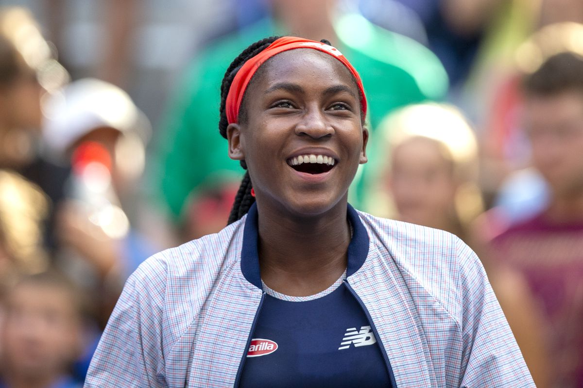 A smiling Coco Gauff after a match victory with partner Catherine McNally at the US Open.
