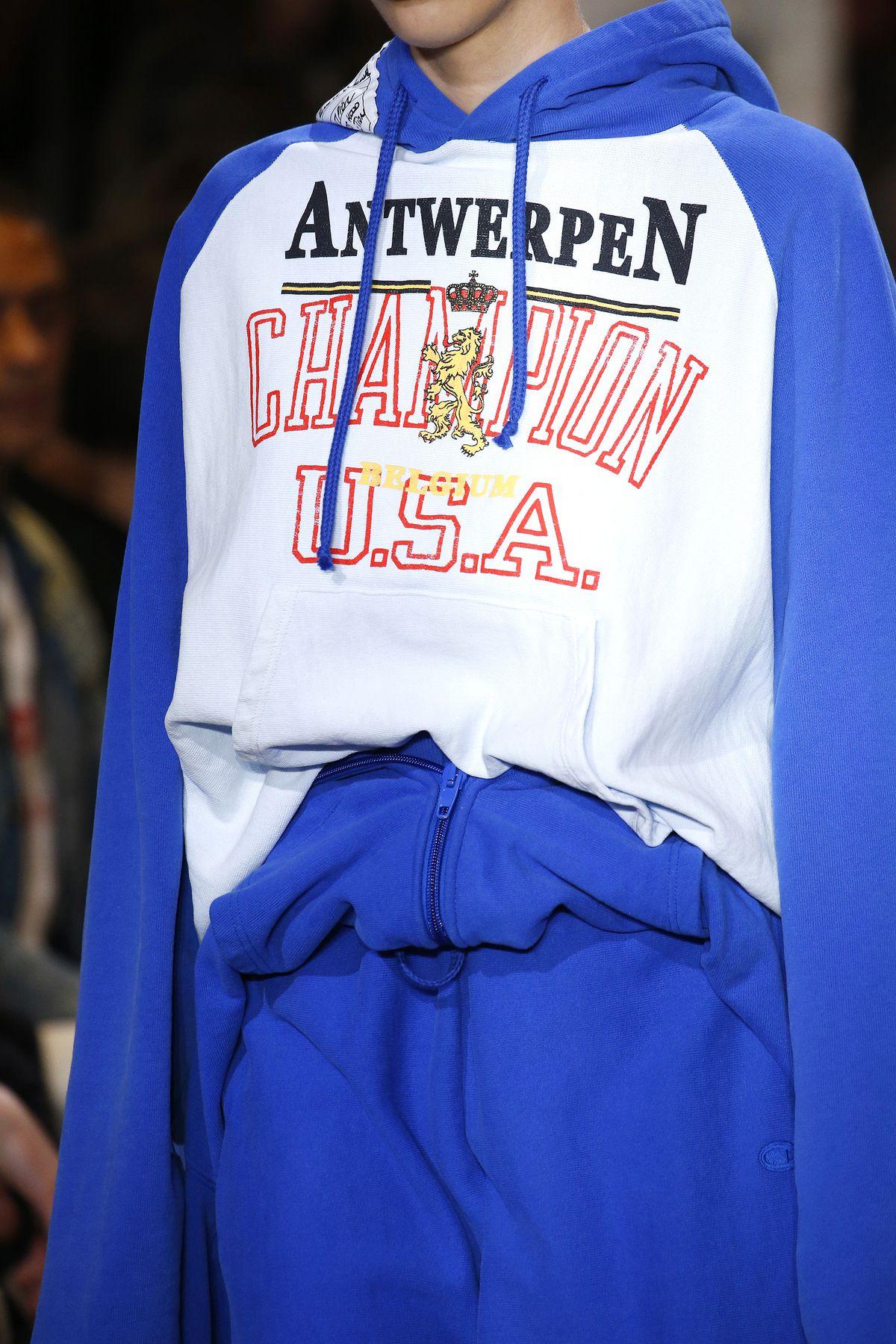 Closeup of Vetements x Champion sweatshirt on a runway model