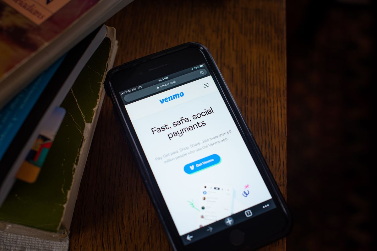 """A Venmo screen on a phone that reads, """"Fast, safe, social payments."""""""