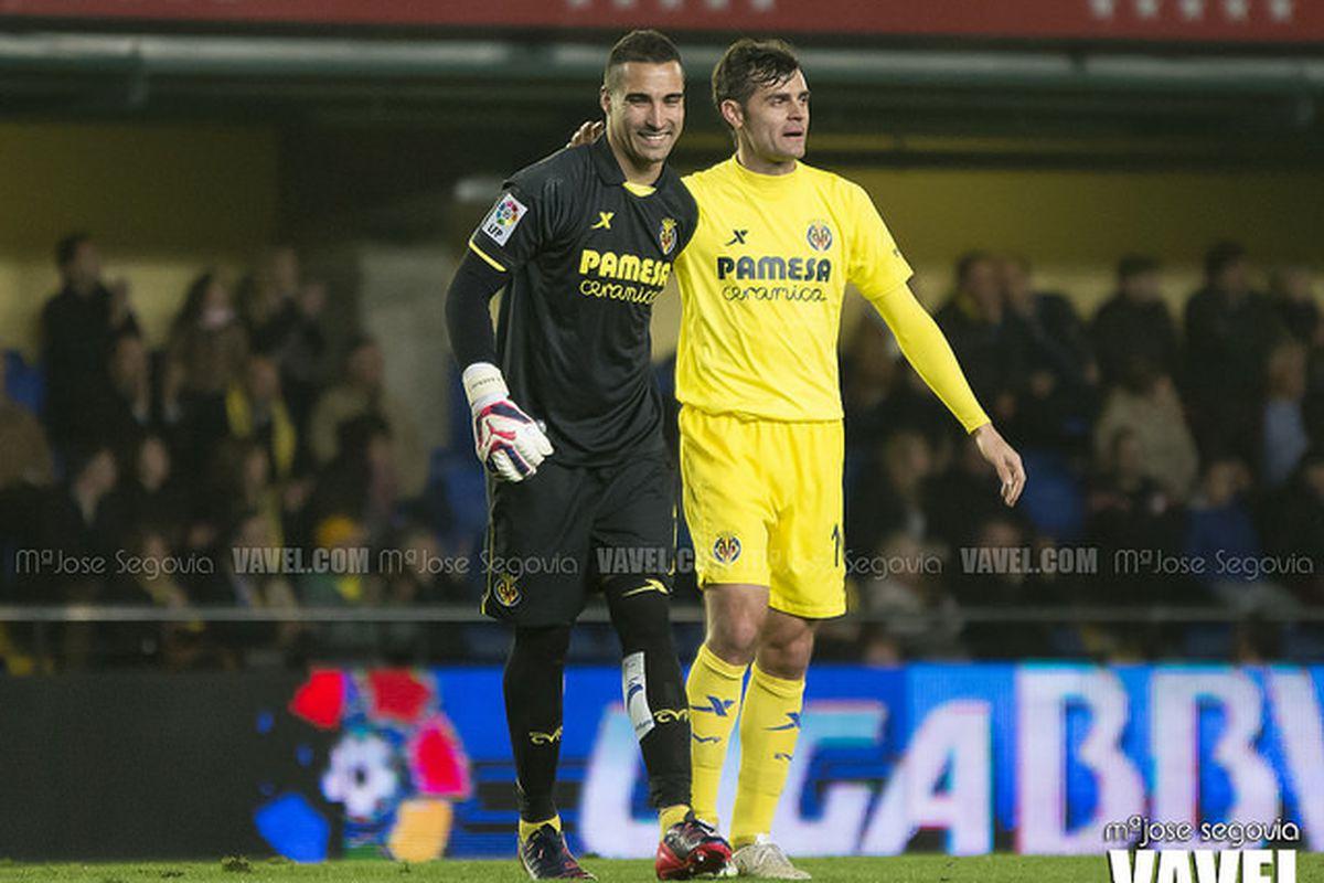 Asenjo and Dorado share a moment against Celta