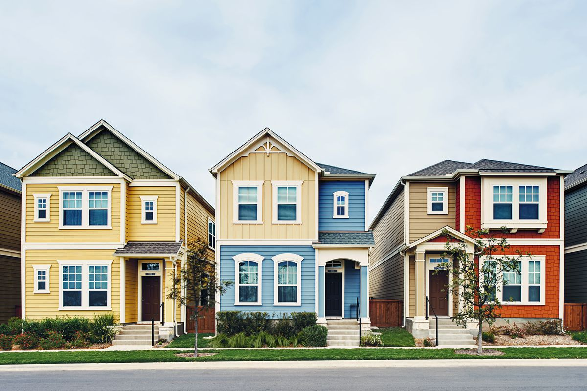Three multicolored two-story houses.