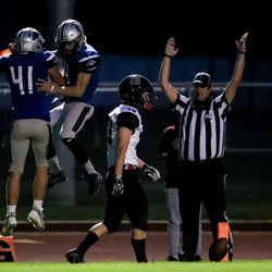 Stansbury's Cayden Clark and Kru Huxford celebrate after Clark ran the ball for a touchdown in a high school football game against Park City in Stansbury Park on Friday, Sept. 18, 2020.