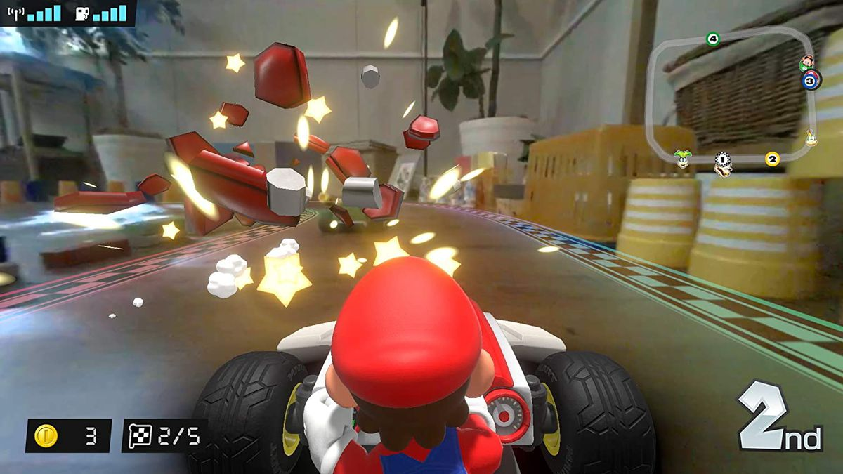 Mario races with a real-world backdrop around him in Mario Kart Live: Home Circuit