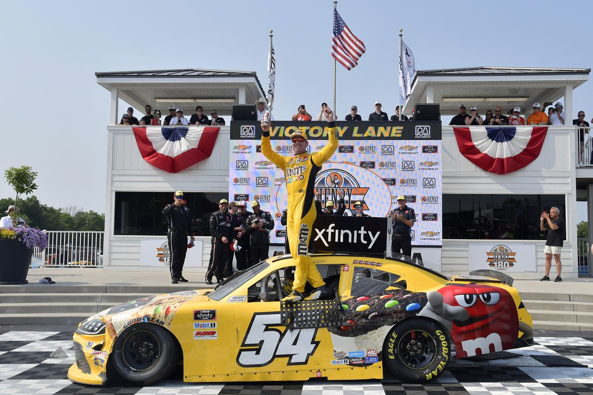 Kyle Busch, driver of the #54 M&M's Ice Cream Toyota, celebrates in victory lane after winning the NASCAR Xfinity Series Henry 180 at Road America on July 03, 2021 in Elkhart Lake, Wisconsin.