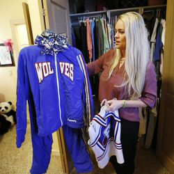 Heather Hansen looks over the cheerleading outfit of her daughter Kennedy at her home in West Haven on Nov 20, 2016.  Kennedy died in June 2014 and a book and a movie now tell the story.