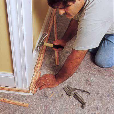 Man Installs Carpet Tack Strips