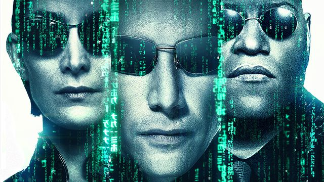 A film poster for the Matrix. Trinity, Neo, and Morpheus all wear sunglasses. They are toned blue, with the crawling Matrix code dividing them.