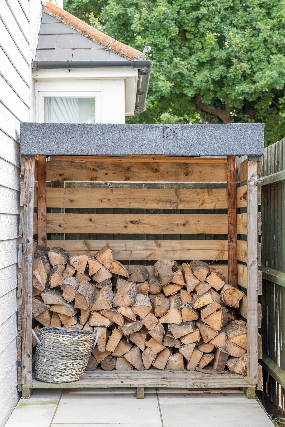 A firewood storage unit made of recycled pallet wood.