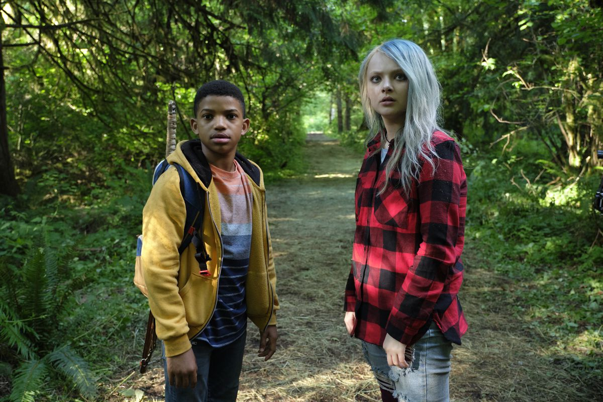 Lonnie Chavis and Amiah Miller, as Gunner and Jo, stand in the forest looking baffled in The Water Man.