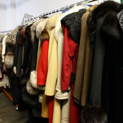 Just one of the many racks of cozy fur-trimmed coats at Bustown Modern's studio. Is it winter yet?