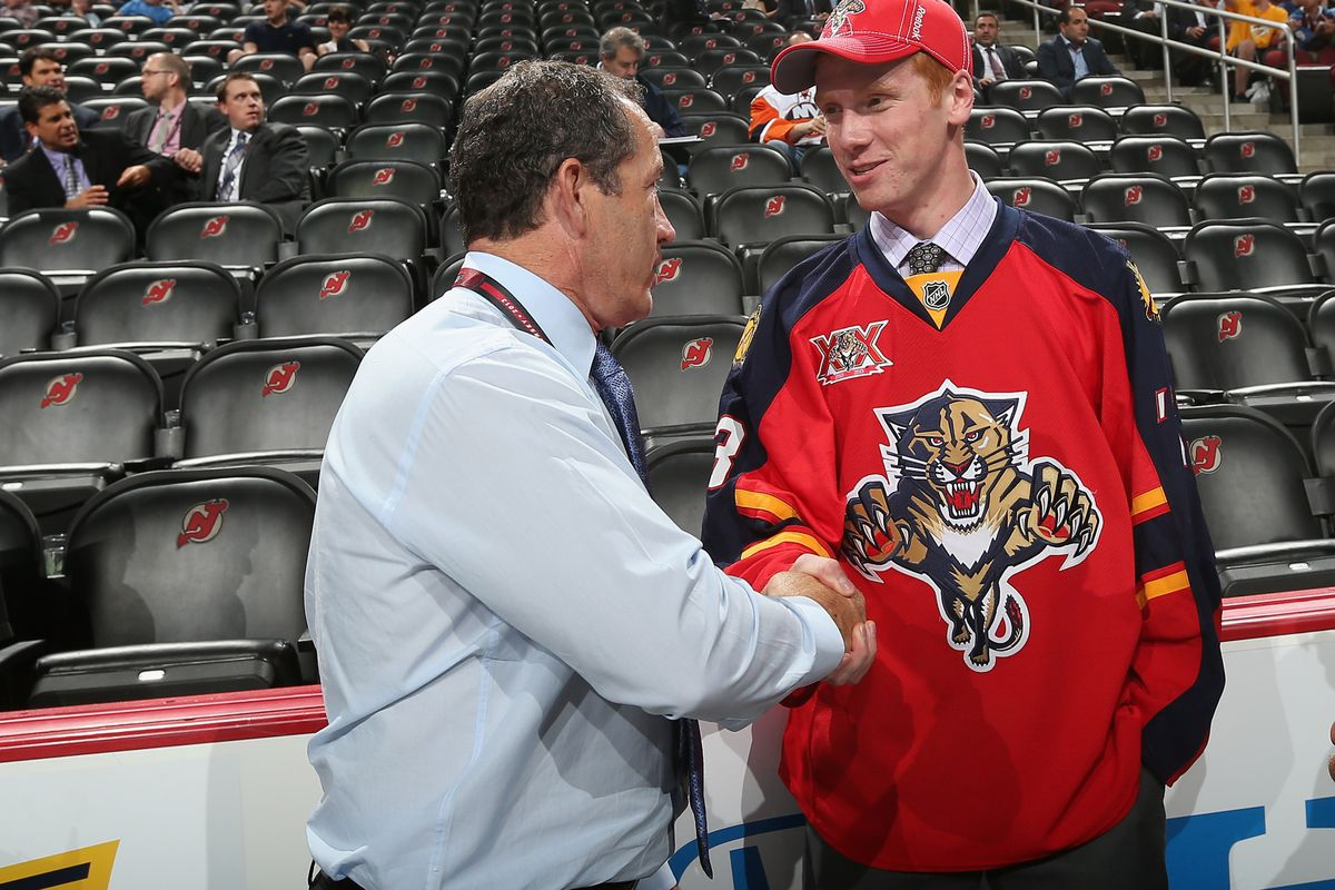 Kevin Dineen and goaltender Evan Cowley at the 2013 NHL Entry Draft in June.