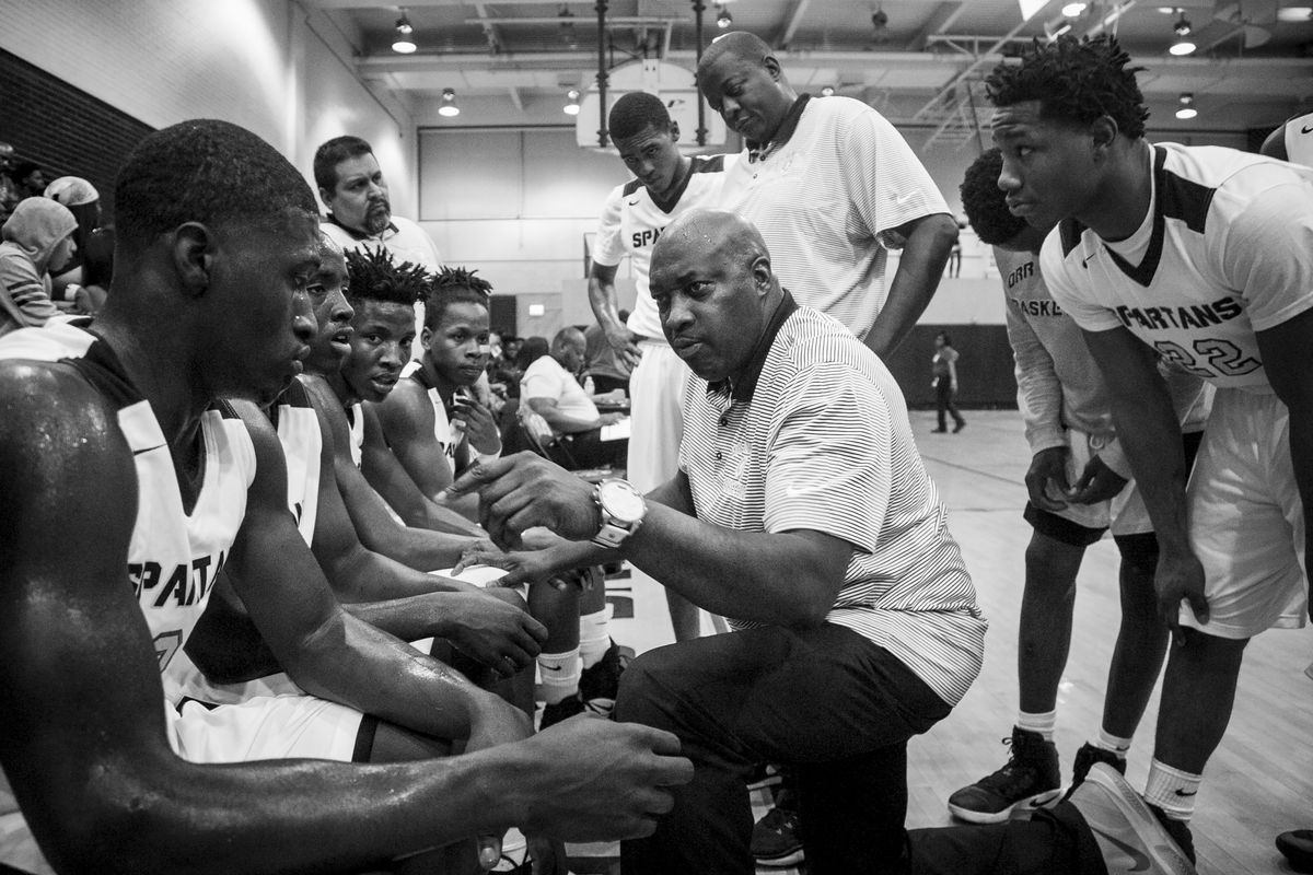 Coach Lou Adams talks to his players during a timeout against North Lawndale College Prep High School at Orr Academy High School, Jan. 13, 2017.
