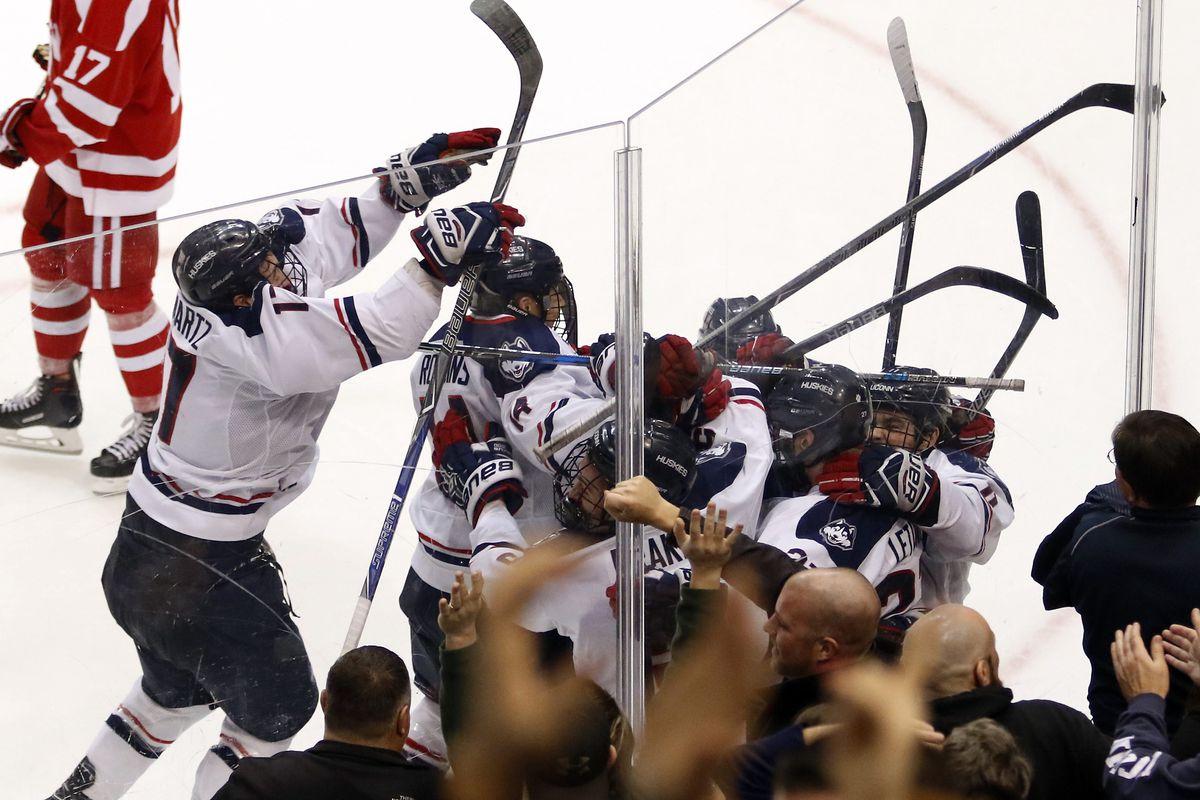 UConn men's hockey celebrates after Maxim Letunov's game-winning goal in overtime vs Boston University.