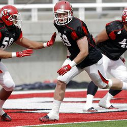 Utah walk on #59 Sam Nielson, center, works on a drill as Utah practices at Rice Eccles Stadium Tuesday, April 10, 2012.