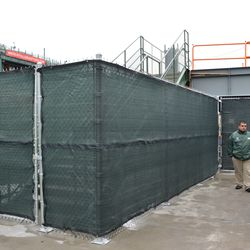 11:34 a.m. Construction fence around the stairs leading to the right-field porch -