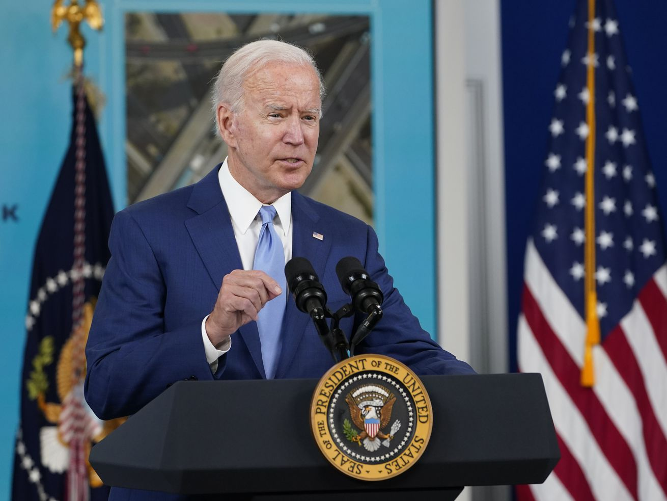 In this Oct. 8, 2021, file photo President Joe Biden speaks about the September jobs report from the South Court Auditorium on the White House campus in Washington. Biden is set to hold his first bilateral talks as president with an African leader on Thursday, hosting Kenyan President Uhuru Kenyatta as war and a humanitarian crisis roil neighboring Ethiopia, according to the White House.